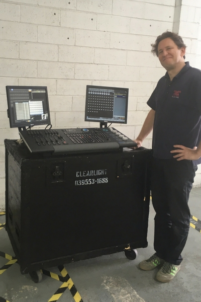 Nick forro setting up the lighting desk at clearlight shows